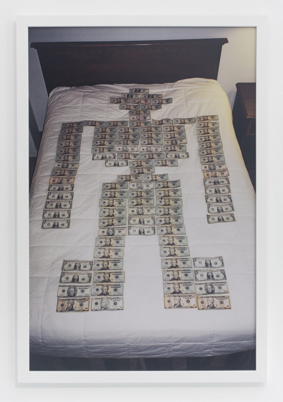 "Andrew Jeffrey Wright, ""Money robot on bed"", 2008, digital c-print, 36 x 24 inches"