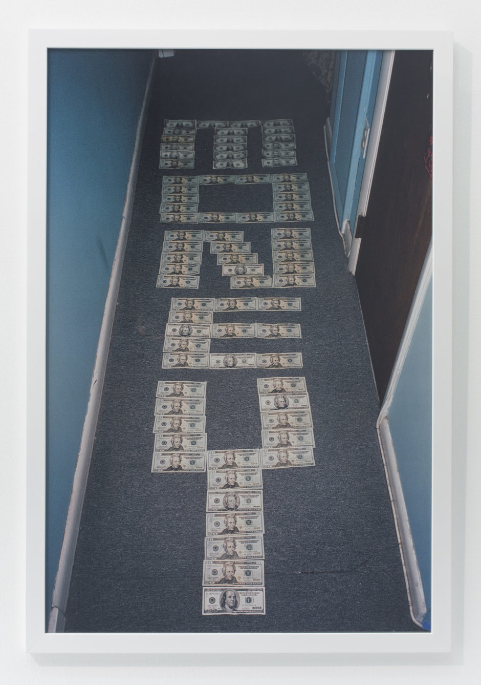 "Andrew Jeffrey Wright, ""The word money in hallway"", 2009, digital c-print, 36 x 24 inches"