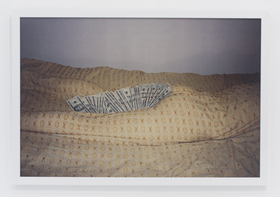 "Andrew Jeffrey Wright, ""Money in between thighs and butt of body wrapped in bedspread"", 2002, digital c-print, 24 x 36 inches"