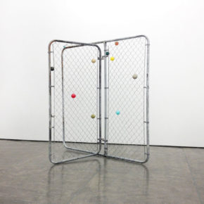 mixed media, chain link gate, balls, sculpture, found objects, everyday objects