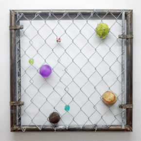 mixed media, chain link gate, balls, found object, everyday object