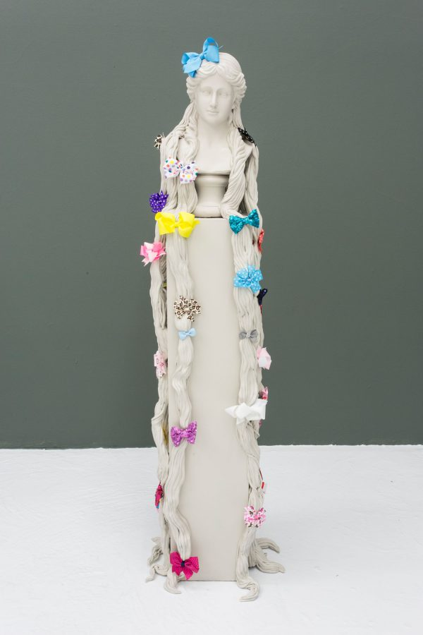 """""""Bows Arts"""", 2016, found bust, wood, resin clay, acrylic paint, found bows, 56 x 10 x 10 inches, 142.2 x 25.4 x 25.4 cm"""